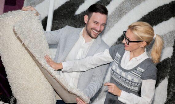 Happy couple choosing a rug